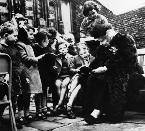 """Maria Montessori, Italian educator, with a large group of children from one of her """"works"""" in Italy. (AP Photo)"""